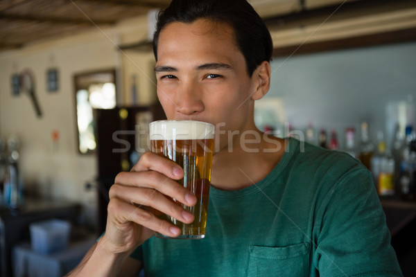 Portrait of man drinking beer Stock photo © wavebreak_media