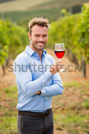 Smiling man looking at wineglass Stock photo © wavebreak_media