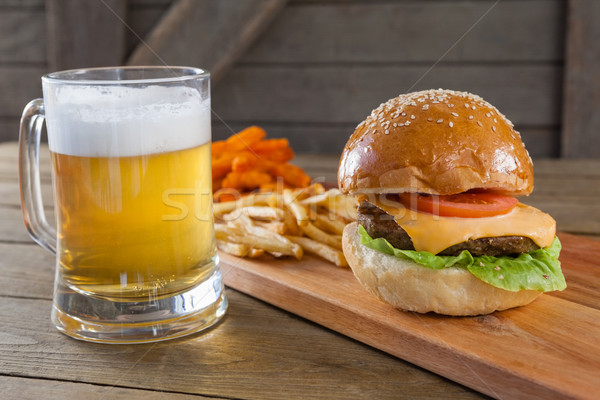 Burger and french fries with glass of beer Stock photo © wavebreak_media