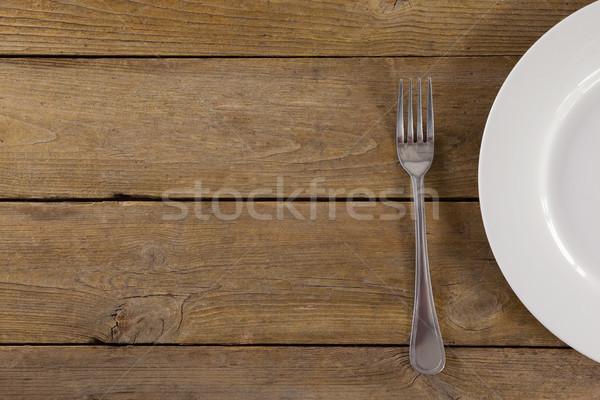 белый пластина вилка деревянный стол продовольствие пива Сток-фото © wavebreak_media