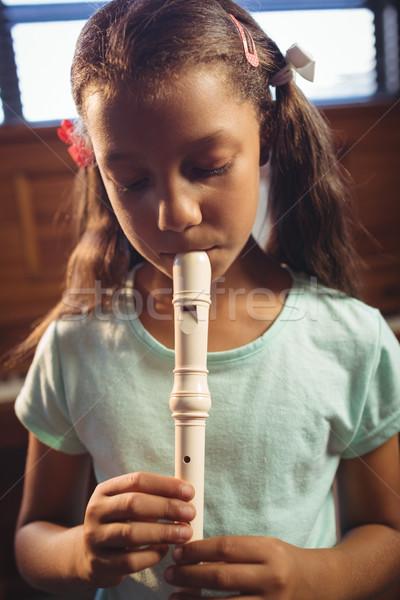 Girl playing flute in classroom Stock photo © wavebreak_media