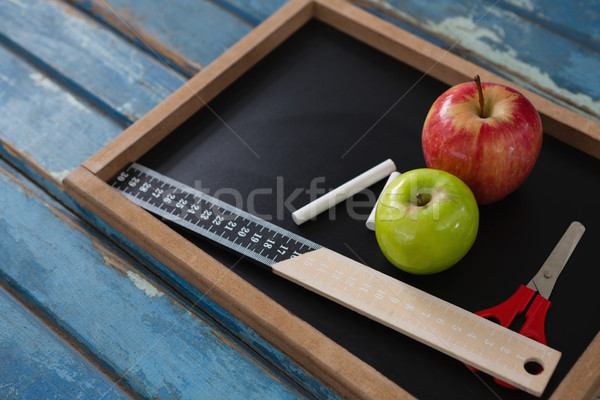 School supplies and slate on wooden table Stock photo © wavebreak_media