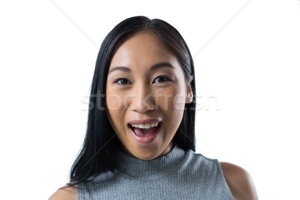 Femminile executive piedi bianco sorpreso telefono Foto d'archivio © wavebreak_media