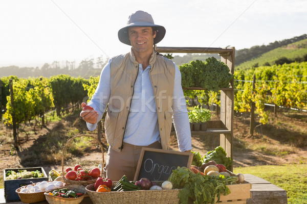 Portrait of happy man standing at vegetable stall Stock photo © wavebreak_media