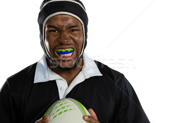 Portrait of male rugby player wearing mouthguard white holding rugby ball Stock photo © wavebreak_media