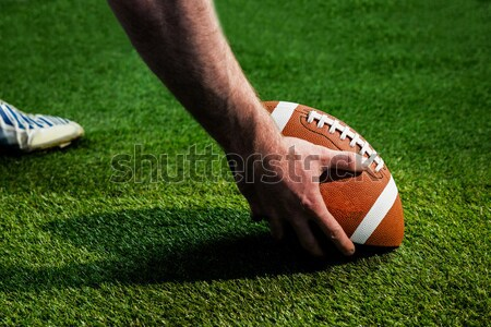 Close up of sportsman holding rugby ball Stock photo © wavebreak_media