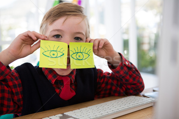 Boy as business executive with sticky notes on his eyes Stock photo © wavebreak_media