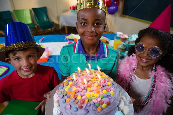 High angle portrait of boy holding birthday cake Stock photo © wavebreak_media