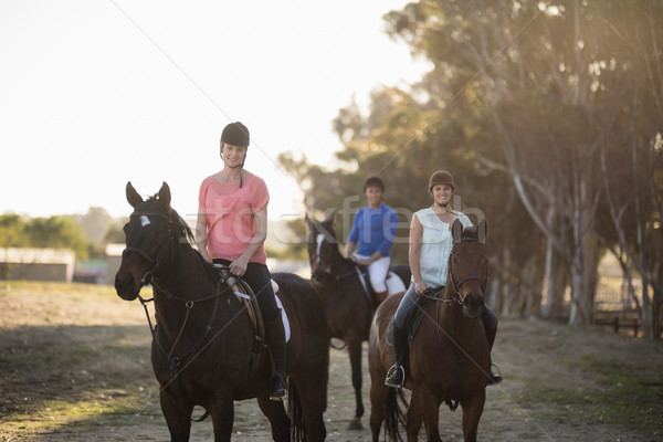 Portrait of women with trainer riding horse Stock photo © wavebreak_media