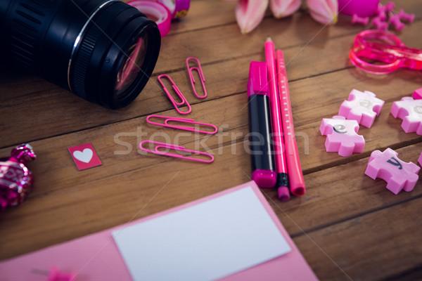 Közelkép kamera irodaszerek fa asztal iroda papír Stock fotó © wavebreak_media