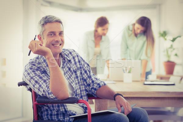 Glimlachend toevallig zakenman rolstoel portret kantoor Stockfoto © wavebreak_media