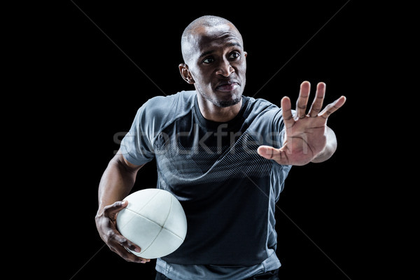 Serious sportsman gesturing while holding rugby ball Stock photo © wavebreak_media