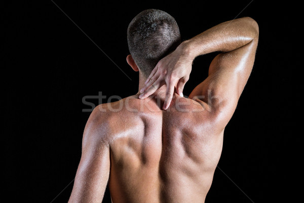 Shirtless man with neck pain Stock photo © wavebreak_media