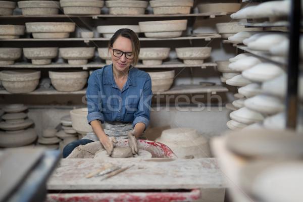 Female potter molding a clay Stock photo © wavebreak_media