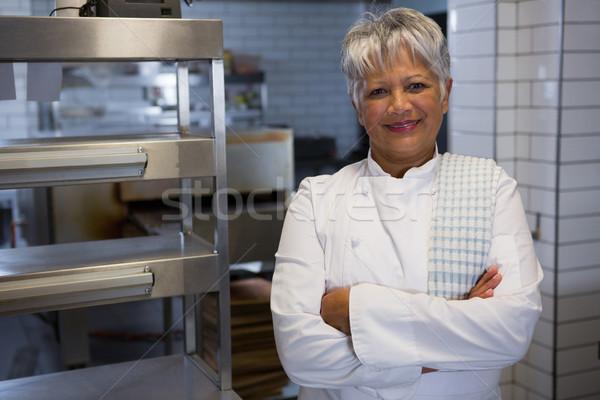 笑みを浮かべて 女性 シェフ 手 キッチン 肖像 ストックフォト © wavebreak_media