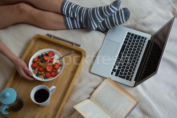 Low section of woman having breakfast on bed Stock photo © wavebreak_media