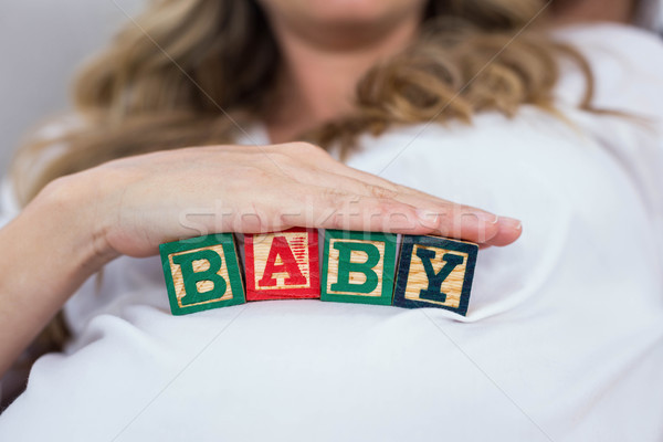 Pregnant woman with baby cubes Stock photo © wavebreak_media