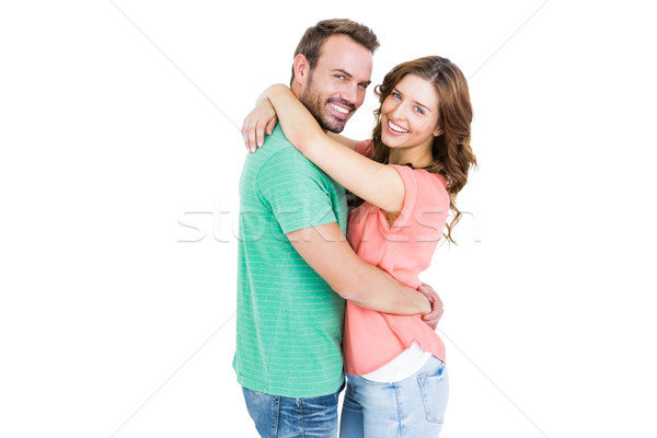 Happy young couple cuddling each other Stock photo © wavebreak_media