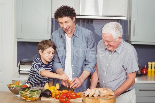 Family preparing food in kitchen Stock photo © wavebreak_media