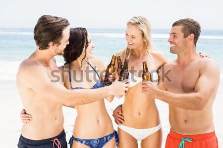 Geslaagd vrienden spelen volleybal strand hemel Stockfoto © wavebreak_media