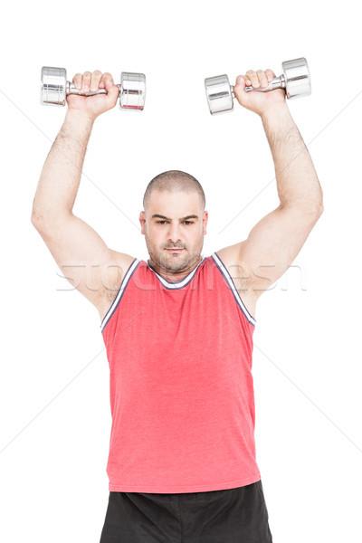 Testépítő emel súlyzók fehér férfi fitnessz Stock fotó © wavebreak_media