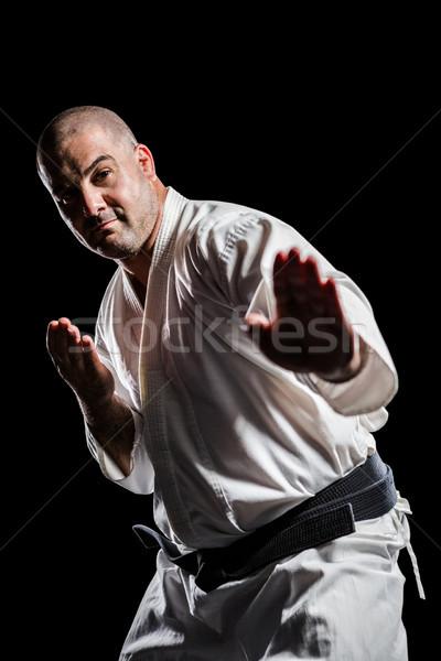 Vadászrepülő előad karate hozzáállás fekete férfi Stock fotó © wavebreak_media