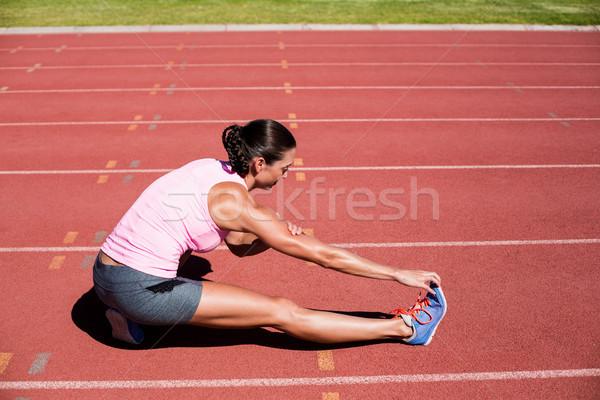 Female athlete stretching her hamstring Stock photo © wavebreak_media