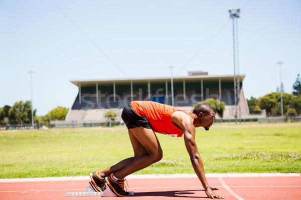 Athlete on a starting block about to run Stock photo © wavebreak_media