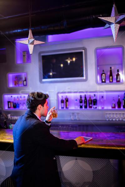 Man Having Beer At Bar Counter Stock