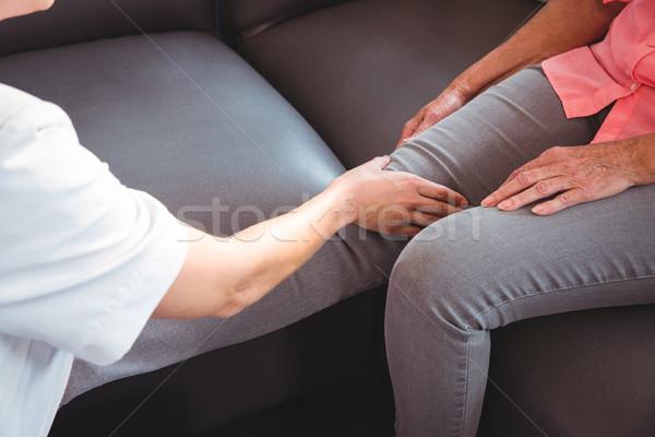 Nurse giving leg massage to senior woman Stock photo © wavebreak_media