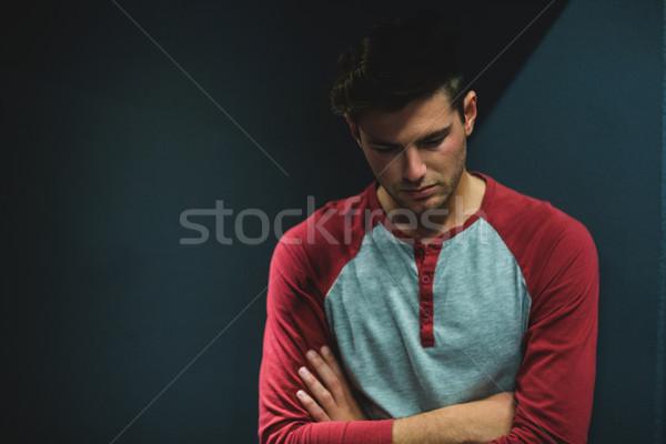 Stressed man against wall Stock photo © wavebreak_media