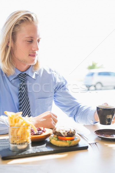 Man having coffee and breakfast Stock photo © wavebreak_media