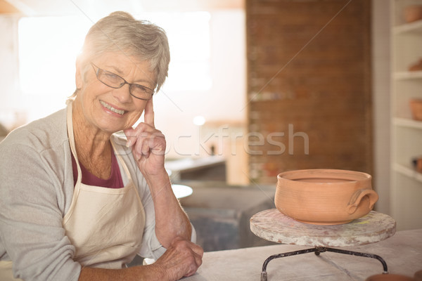Female potter sitting at table Stock photo © wavebreak_media