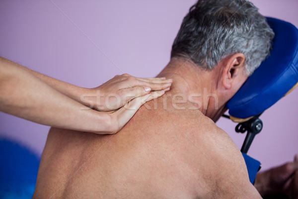 Indietro massaggio paziente clinica uomo dolore Foto d'archivio © wavebreak_media
