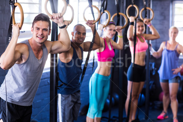 Portré mosolyog emberek gimnasztikai gyűrűk tornaterem Stock fotó © wavebreak_media