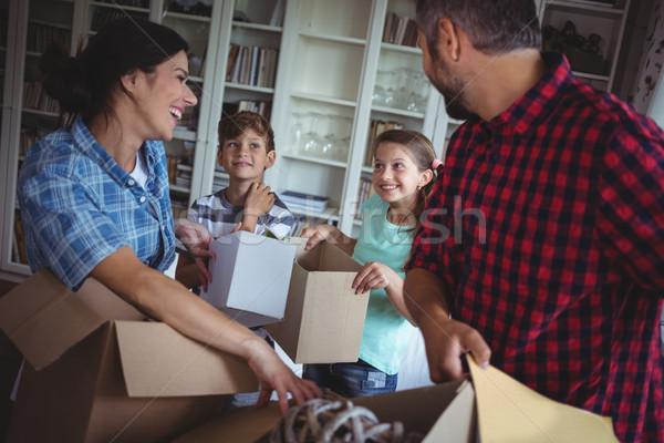 Family unpacking cartons together Stock photo © wavebreak_media