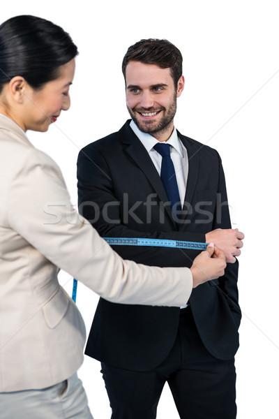 Uśmiechnięty kobieta interesu biznesmen rękaw biały Zdjęcia stock © wavebreak_media