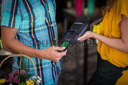 Man betaling creditcard vrouw Stockfoto © wavebreak_media