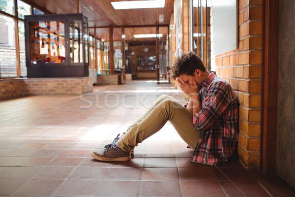 Szomorú iskolás fiú ül egyedül folyosó iskola Stock fotó © wavebreak_media