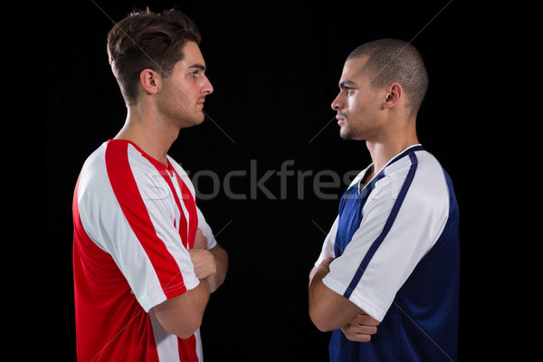 Two rival football player looking at each other Stock photo © wavebreak_media