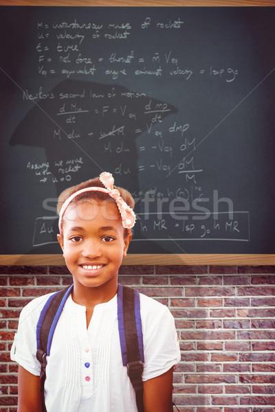 Composite image of little girl smiling in school corridor Stock photo © wavebreak_media