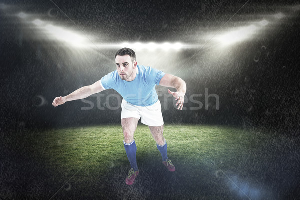 Composite image of rugby player ready to tackable Stock photo © wavebreak_media