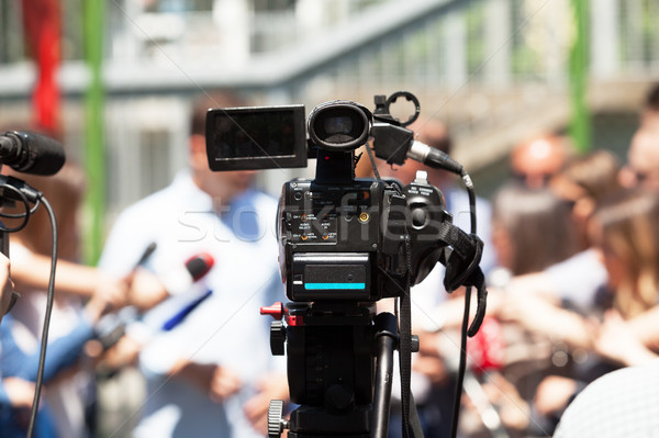 Press or news conference. Filming media event with a video camer Stock photo © wellphoto