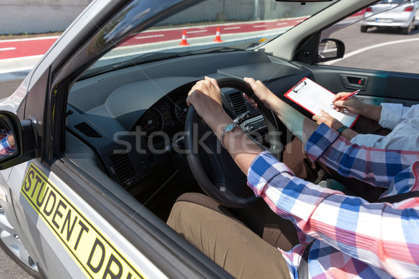 Learner driver student driving car with instructor Stock photo © wellphoto
