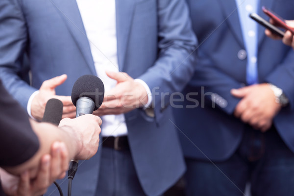 Stock photo: Press conference. Media interview.