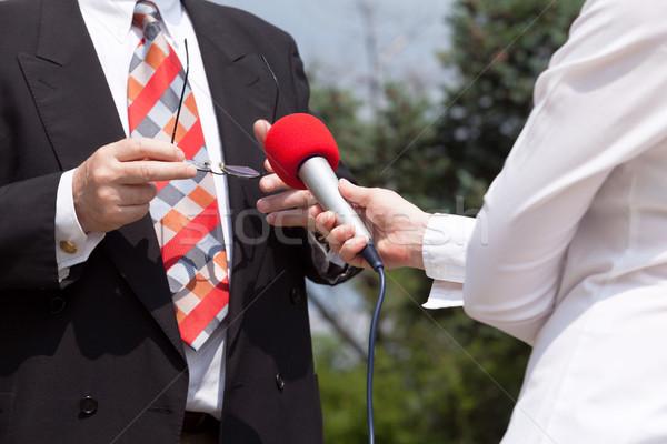 Media interview. Journalist. Microphone. Stock photo © wellphoto