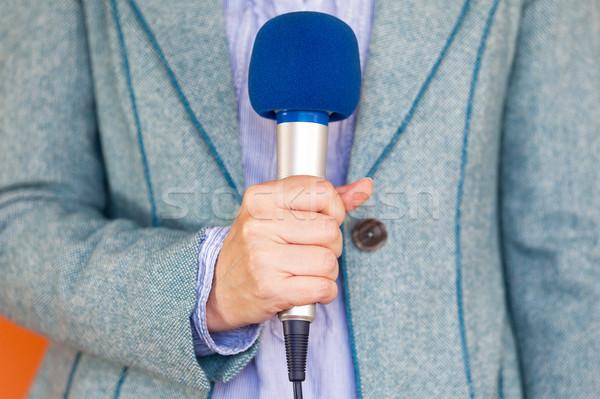 Hírek újságíró riporter tart mikrofon média Stock fotó © wellphoto