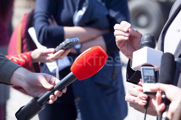 Media interview. Broadcast journalism. News conference. Micropho Stock photo © wellphoto