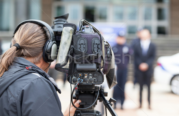 Cameraman. News conference. Filming an event with a video camera Stock photo © wellphoto