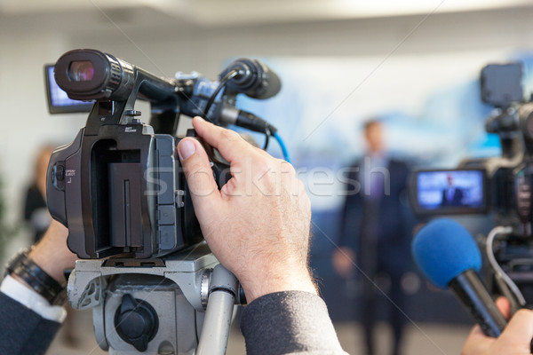 Blurred spokesman at press conference Stock photo © wellphoto
